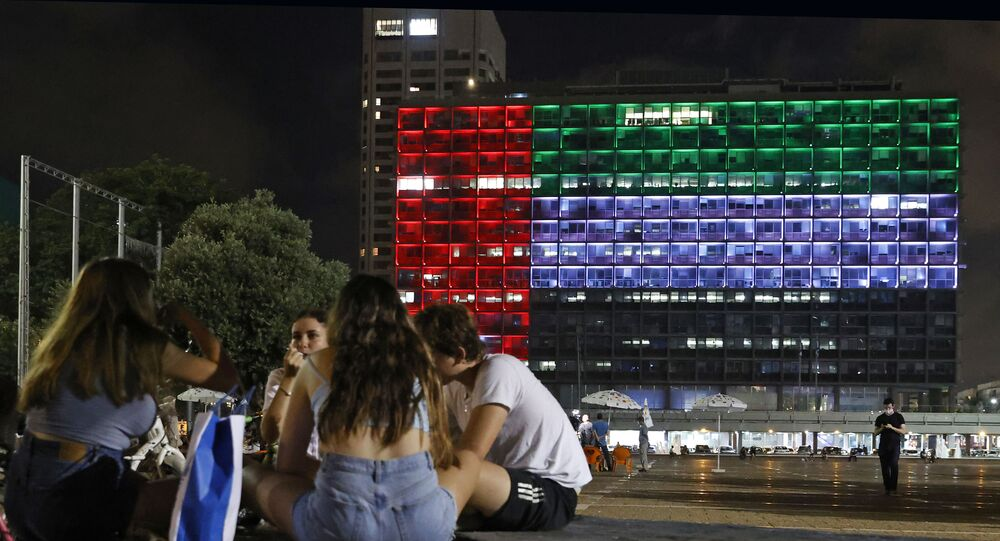 The city hall in the Israeli coastal city of Tel Aviv is lit up in the colours of the United Arab Emirates national flag on August 13, 2020. - Israel and the UAE agreed to normalise relations in a landmark US-brokered deal, only the third such accord the Jewish state has struck with an Arab nation. The agreement, first announced by US President Donald Trump on Twitter, will see Israel halt its plan to annex large parts of the occupied West Bank, according to the UAE.