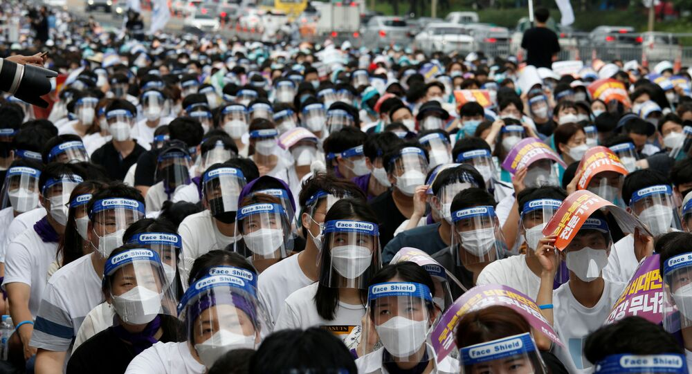 Medical residents and doctors attend a 24-hour strike amid the coronavirus disease (COVID-19) pandemic to protest a government plan to increase medical school admissions by 400 a year for the next decade to prepare for potential infectious disease outbreaks, in Seoul, South Korea, August 14, 2020