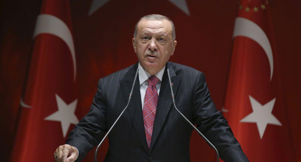 Turkey's President Recep Tayyip Erdogan addresses his party members, in Ankara, Turkey, Thursday, Aug. 13, 2020