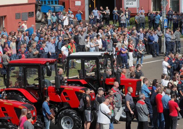 Employees of Minsk Tractor Works gather outside a plant during a meeting to protest against presidential election results and to demand re-election in Minsk, Belarus August 14, 2020