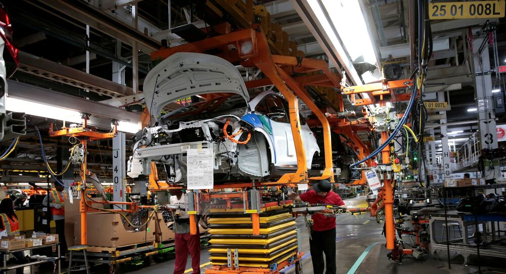 General Motors assembly workers connect a battery pack underneath a partially assembled 2018 Chevrolet Bolt EV vehicle on the assembly line at  Orion Assembly in Lake Orion, Michigan, U.S., March 19, 2018.