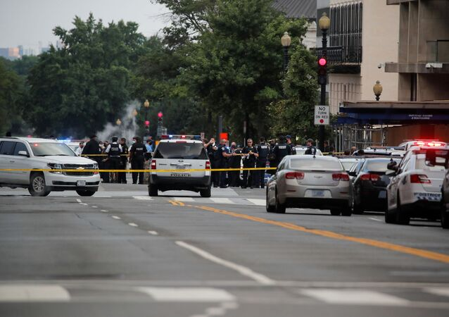 Police officers stand guard after a shooting incident outside of the White House, in Washington, US., 10 August 2020.