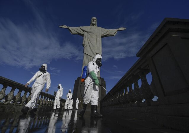 Soldiers of the Brazilian Armed Forces are seen during the disinfection procedures of the Christ The Redeemer statue at the Corcovado mountain prior to the opening of the touristic attraction on August 15, in Rio de Janeiro, Brazil, on August 13, 2020, amid the COVID-19 novel coronavirus pandemic.