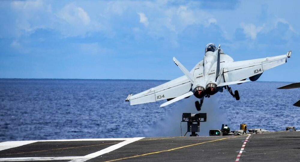 Fighter jet takes off from the USS Ronald Reagan aircraft carrier amid drills in the South China Sea.