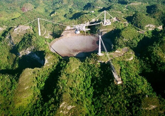 The world's largest radio telescope is seen from the air in this Wednesday, March 26, 2003 photo at the Arecibo Observatory, Puerto Rico