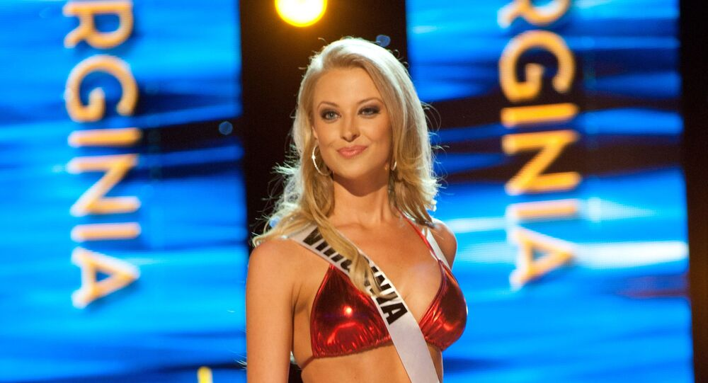 Miss Virginia USA 2011, Nikki Poteet, from Richmond, competes in her swimwear by Kandy Wrappers during the 2011 Miss USA Presentation Show on Wednesday, June 15, 2011 from the Planet Hollywood Resort and Casino Theatre for the Performing Arts in Las Vegas, Nevada.