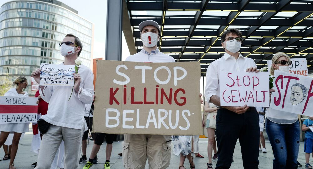 A protester holds a sign reading Stop Killing Belarus during a demonstration on the contested elections in Belarus in Berlin, on August 15, 2020.
