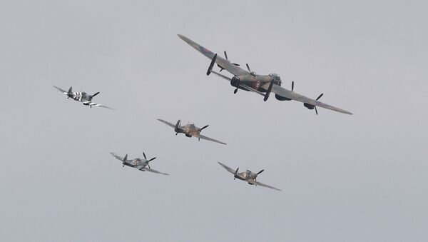 Three Spitfires, a Hurricane and a Lancaster bomber fly over during the VJ Day National Remembrance event, held at the National Memorial Arboretum in Staffordshire, Britain August 15, 2020.  - Sputnik International