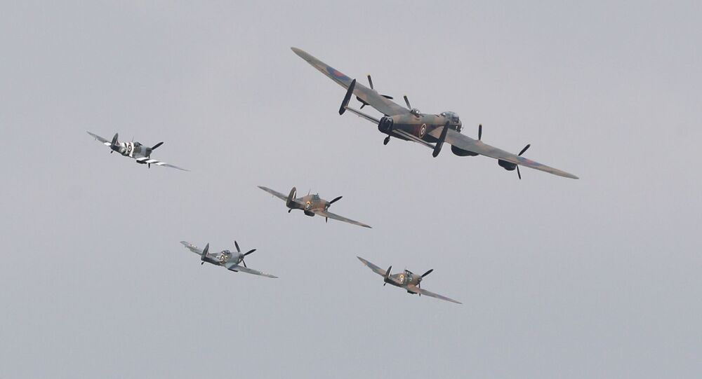 Three Spitfires, a Hurricane and a Lancaster bomber fly over during the VJ Day National Remembrance event, held at the National Memorial Arboretum in Staffordshire, Britain August 15, 2020.