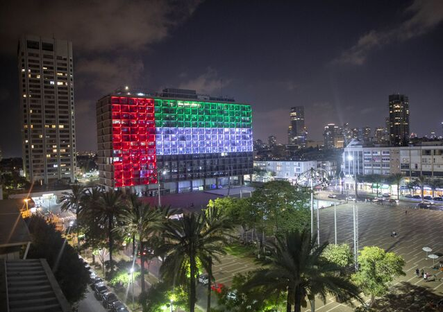Tel Aviv City Hall is lit up with the flags of the United Arab Emirates and Israel as the countries announced they would be establishing full diplomatic ties, in Tel Aviv, Israel, Thursday, Aug. 13, 2020. In a nationally broadcast statement, Prime Minister Benjamin Netanyahu said the full and official peace with the UAE would lead to cooperation in many spheres between the countries and a wonderful future for citizens of both countries.