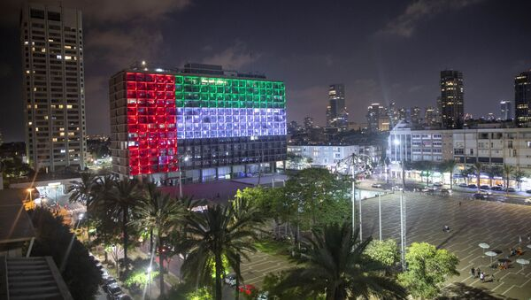 Tel Aviv City Hall is lit up with the flags of the United Arab Emirates and Israel as the countries announced they would be establishing full diplomatic ties, in Tel Aviv, Israel, Thursday, Aug. 13, 2020. In a nationally broadcast statement, Prime Minister Benjamin Netanyahu said the full and official peace with the UAE would lead to cooperation in many spheres between the countries and a wonderful future for citizens of both countries.  - Sputnik International