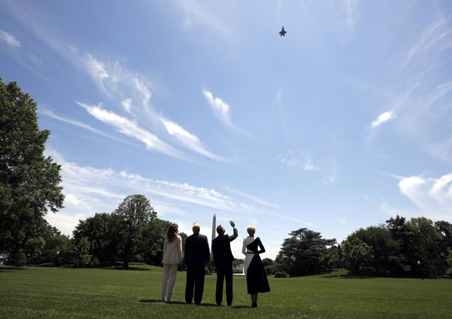 President Donald Trump, first lady Melania Trump, Polish President Andrzej Duda, and his wife Agata Kornhauser-Duda watch a flyover of a F-35 Lightning II jet at the White House, Wednesday, June 12, 2019, in Washington