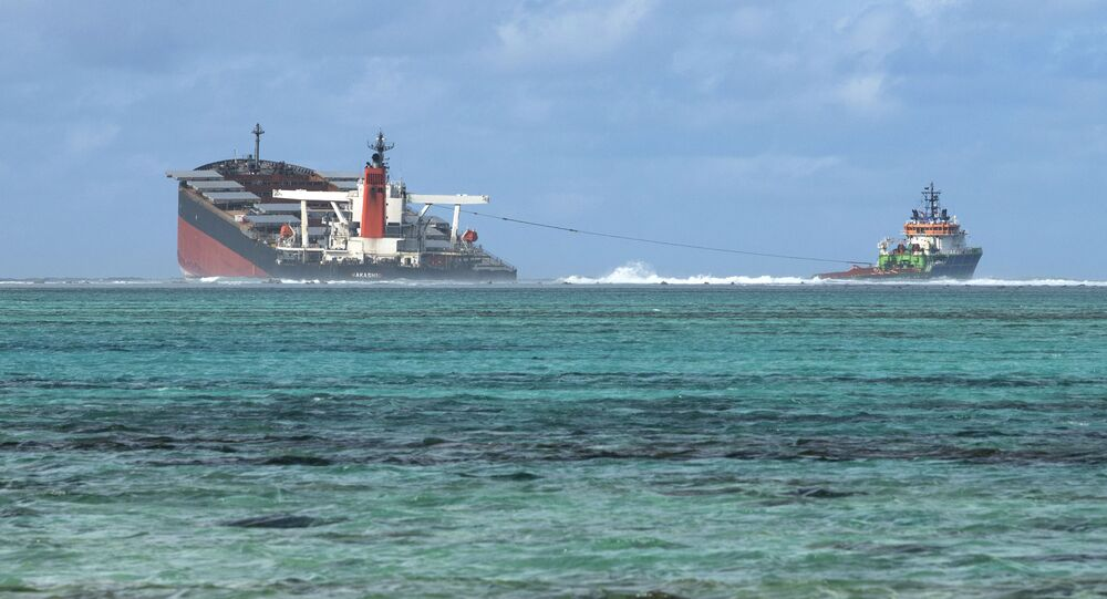 A picture taken on August 15, 2020 near Blue Bay Marine Park, shows the vessel MV Wakashio, belonging to a Japanese company but Panamanian-flagged, that ran aground near Blue Bay Marine Park off the coast of south-east Mauritius.