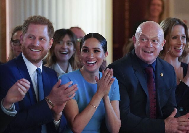Britain's Prince Harry and Meghan, the Duchess of Sussex, cheer during a marriage proposal at the Endeavour Fund Awards at Mansion House in London, Thursday, 5 March 2020.