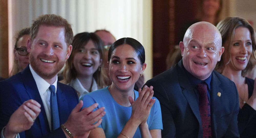 Britain's Prince Harry and Meghan, the Duchess of Sussex, cheer during a marriage proposal at the Endeavour Fund Awards at Mansion House in London, Thursday, March 5, 2020
