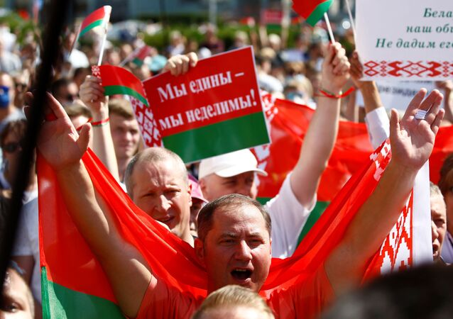 People attend a rally in support of Belarusian President Alexander Lukashenko near the Government House in Independence Square in Minsk, Belarus August 16, 2020.