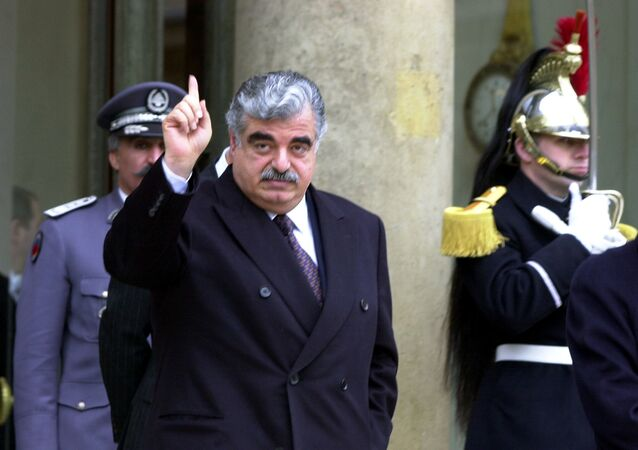 Lebanese Prime Minister Rafik Hariri leaves the Elysee Palace following a meeting with French President Jacques Chirac in Paris, France, February 27, 2001