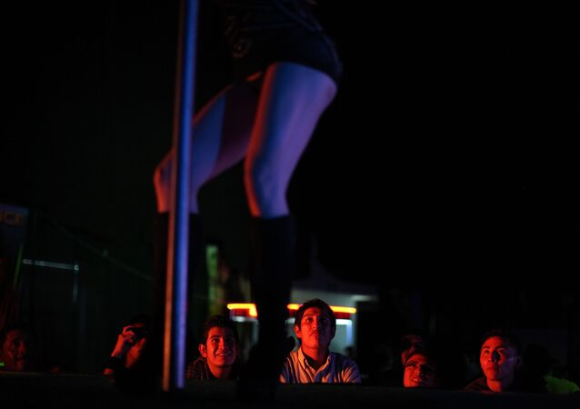 In this photo taken on Friday, March 2, 2012, an exotic dancer performs during the 2012 Sex and Entertainment Expo in Mexico City.  The Sex and Entertainment Expo is an annual event where vendors in the sex industry promote their goods and local strip clubs offer a glimpse of their establishments.