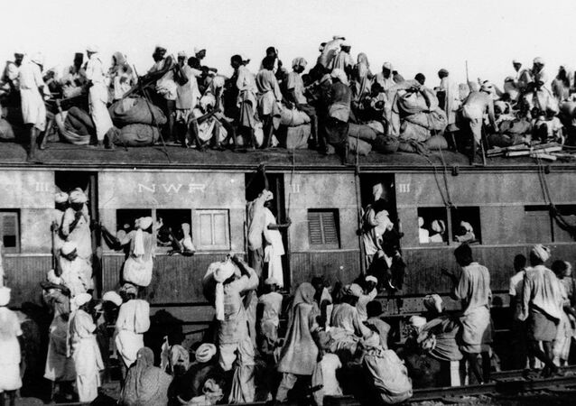 In this September 1947, file photo hundreds of Muslim refugees crowd on top a train leaving New Delhi for Pakistan. After Britain ended its colonial rule over the Indian subcontinent, two independent nations were created in its place _ the secular, Hindu-majority nation of India, and the Islamic republic of Pakistan. The division, widely referred to as Partition, sparked massive rioting that killed up to 1 million, while another 15 million fled their homes in one of the world's largest ever human migrations. (AP Photo, File)