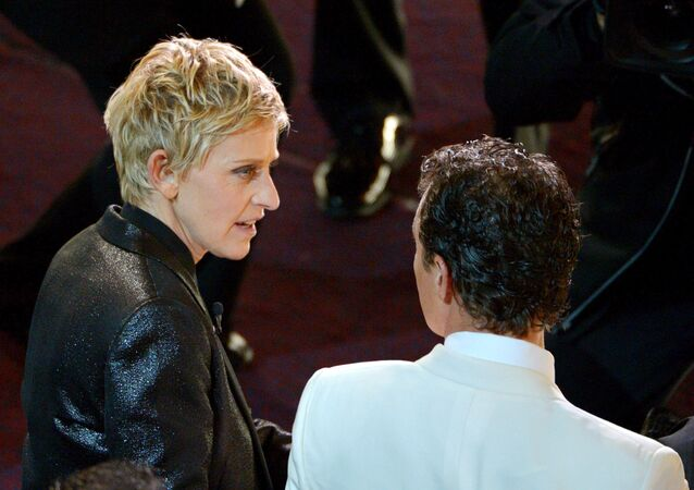 Ellen DeGeneres, left, and Matthew McConaughey are seen in the audience during the Oscars at the Dolby Theatre on Sunday, March 2, 2014, in Los Angeles