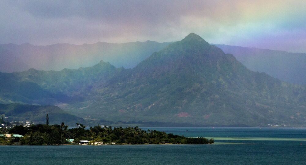 President Barack Obama's motorcade passes Kaneohe Bay as heads for the beach at Bellows Air Force Station, Saturday, Jan. 3, 2015, on the island of Oahu in Hawaii, on the final day of the Obama family vacation.