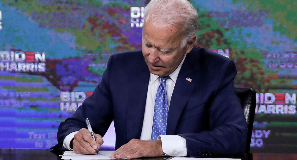 Democratic presidential candidate Joe Biden signs official documents needed to receive his party's official nomination next week during an event in Wilmington, Delaware, U.S., August 14, 2020.