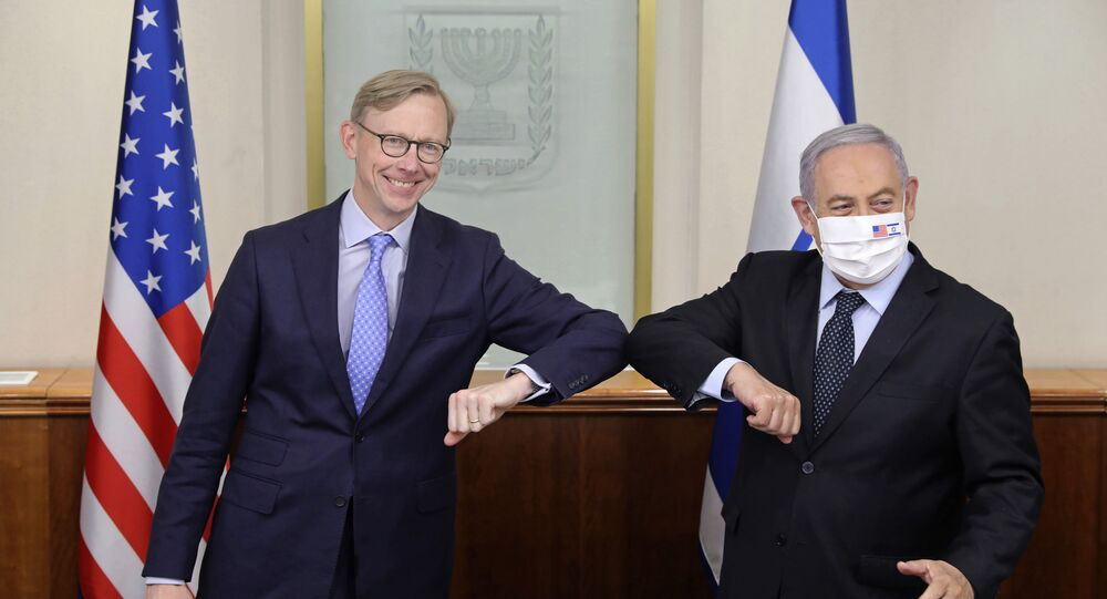 Israeli Prime Minister Benjamin Netanyahu, right, and US special envoy for Iran, Brian Hook, touch elbows to help prevent the spread of the coronavirus, at the Prime Minister's office in Jerusalem, Tuesday June 30, 2020