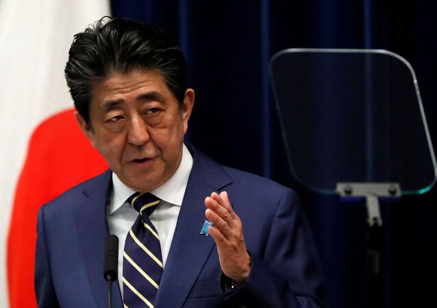 Japan's Prime Minister Shinzo Abe holds a news conference on Japan's response to the coronavirus disease (COVID-19) outbreak, at his official residence in Tokyo, Japan, March 28, 2020