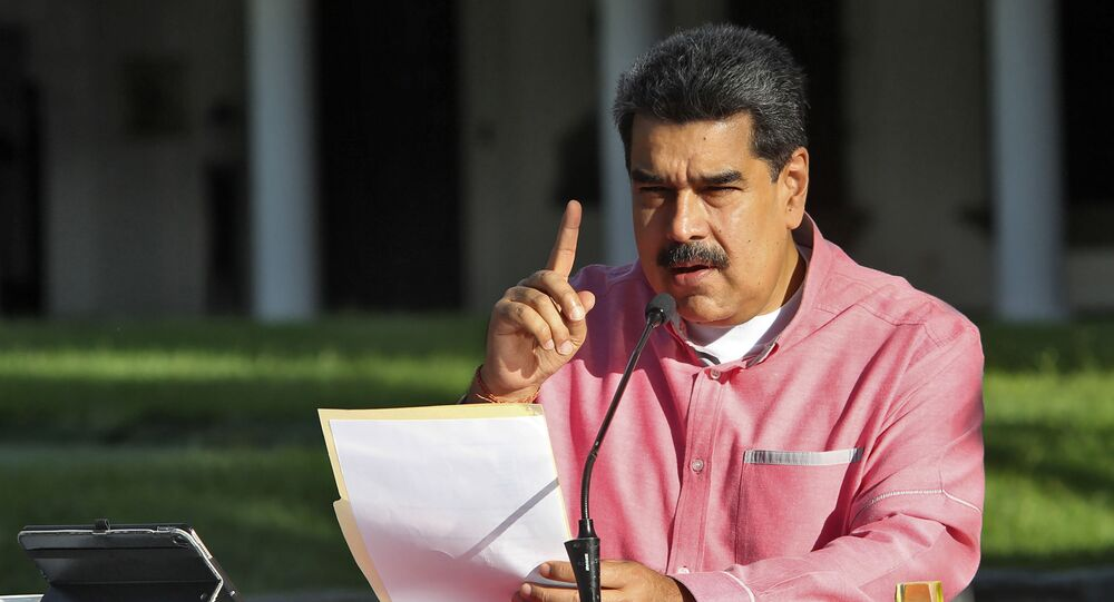 Handout picture released by the Venezuelan Presidency showing Venezuela's President Nicolas Maduro announcing in a televised message to the nation the extension, for the fifth time, of the state of alarm due to the COVID-19 novel coronavirus pandemic, in Caracas on August 9, 2020