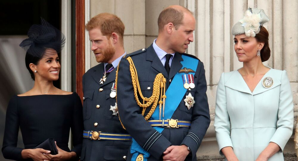 FILE PHOTO: Britain's Meghan, Duchess of Sussex, Prince Harry, Prince William, Catherine, Duchess of Cambridge on the balcony of Buckingham Palace as they watch a fly past to mark the centenary of the Royal Air Force in central London, Britain, July 10, 2018