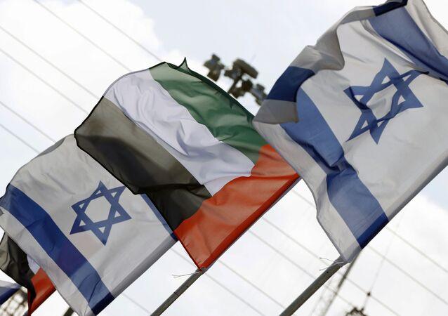 Israeli and United Arab Emirates flags line a road in the Israeli coastal city of Netanya, on August 16, 2020.