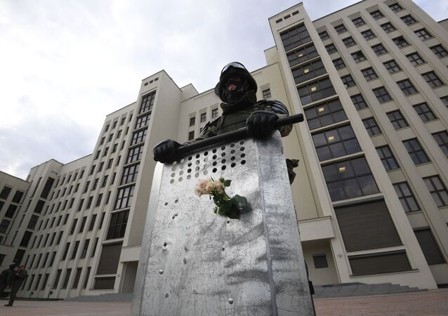A member of Belarusian Interior Ministry troops stands guard during protests in Minsk. 14 August, 2020