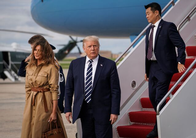 U.S. President Donald Trump, First Lady Melania Trump and Barron Trump disembark from Air Force One at Joint Base Andrews in Maryland, U.S., August 16, 2020