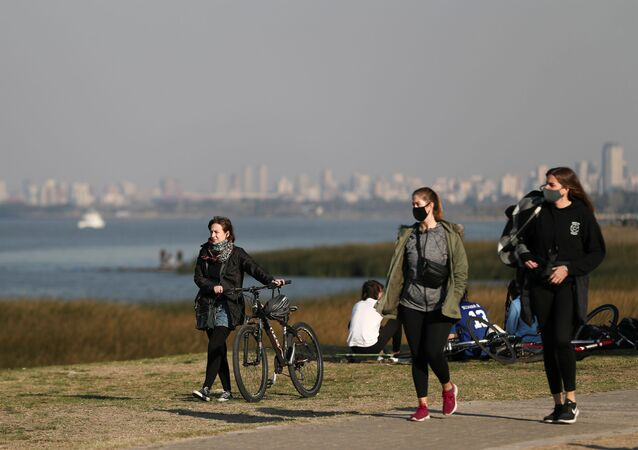 People enjoy the day at the shore of the Rio de la Plata river, amid the coronavirus disease (COVID-19), in Buenos Aires, Argentina August 12, 2020.