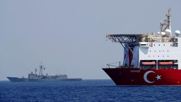 The Turkish drilling vessel Yavuz is seen being escorted by a Turkish Navy frigate in the eastern Mediterranean off Cyprus, August 6, 2019 - Sputnik International