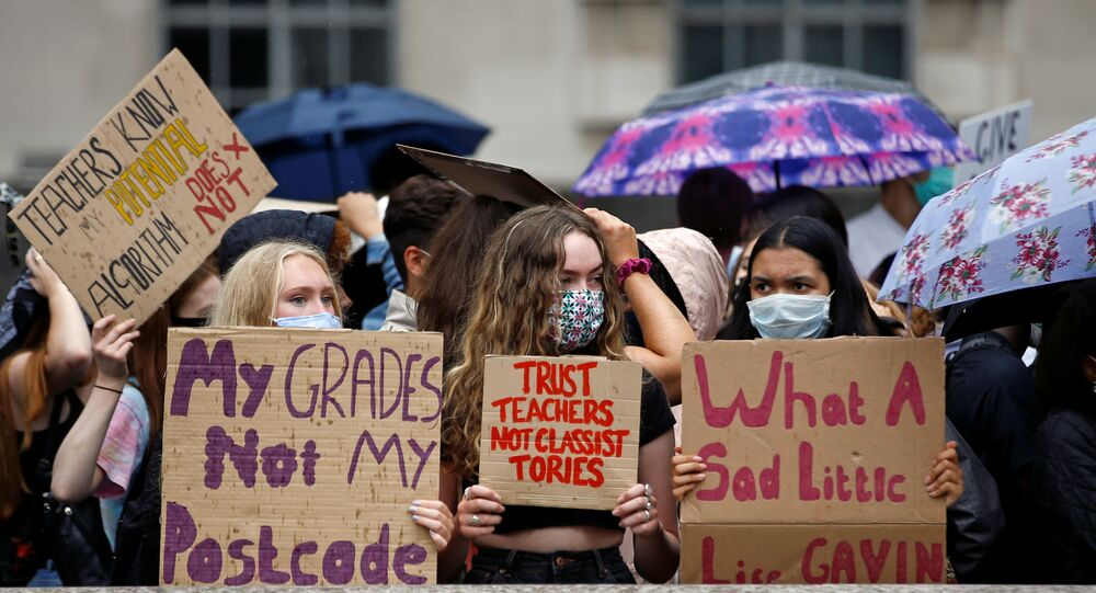 FILE PHOTO: A-level students hold placards as they protest opposite Downing Street, amid the ongoing coronavirus (COVID-19) pandemic, in London, Britain, 16 August 2020.