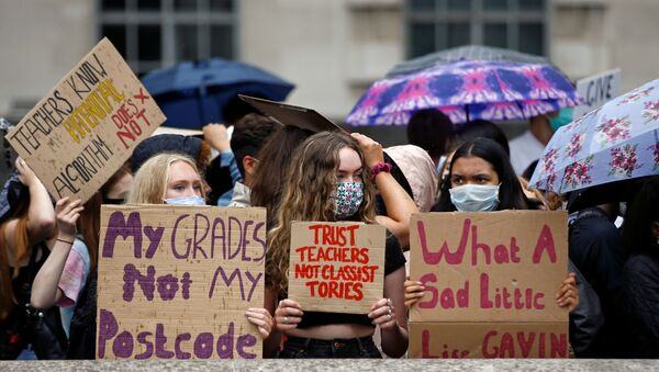 FILE PHOTO: A level students hold placards as they protest opposite Downing Street, amid the outbreak of the coronavirus disease (COVID-19), in London, Britain, August 16, 2020.  - Sputnik International