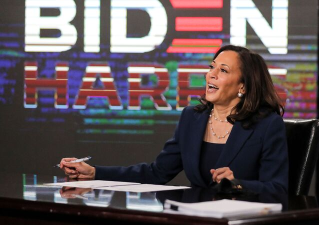 Democratic U.S. vice presidential candidate Senator Kamala Harris signs official documents needed to receive her party's official nomination next week during an event in Wilmington, Delaware, U.S., August 14, 2020