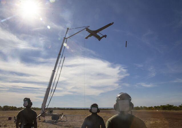 U.S. Marines with Air Combat Element, Marine Rotational Force – Darwin recover the RQ-21A Blackjack following spoke operations in Bradshaw Field Training Area, Northern Territory, Australia, Aug. 9, 2020