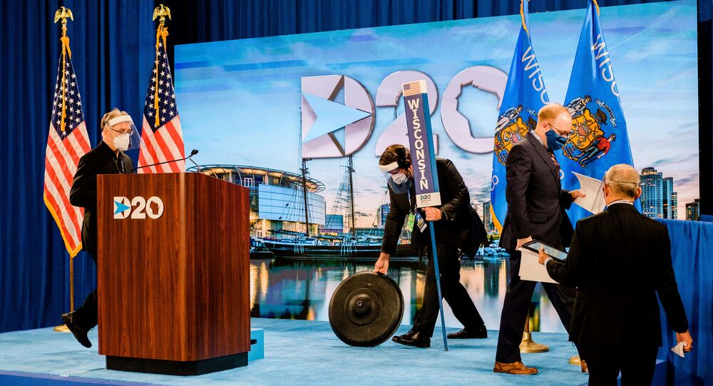 DNC staff change the set as Milwaukee native and Convention Secretary Jason Rae walks off stage at the Wisconsin Center on the second day of the Democratic National Convention in Milwaukee, Wisconsin, U.S. August 18, 2020