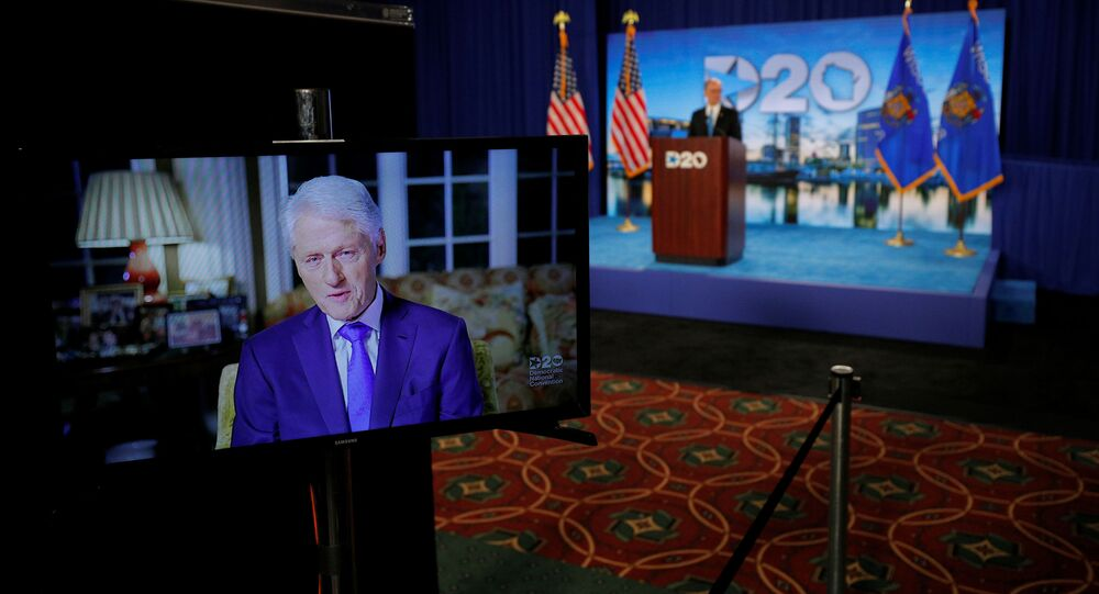 Former President Bill Clinton delivers a speech by video feed as Democratic National Committee Chairman Tom Perez watches from the podium during the second night of the virtual 2020 Democratic National Convention at its hosting site in Milwaukee, Wisconsin, U.S. August 18, 2020