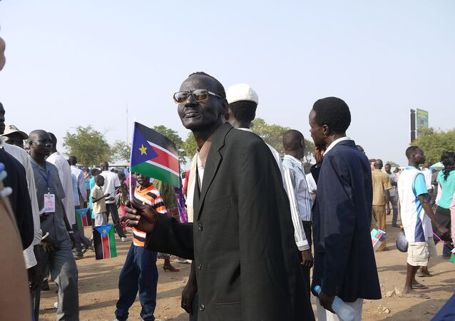 Sudanese man carries the flag