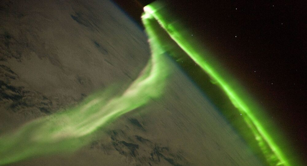 Russian cosmonaut Ivan Vagner has shared a video of the aurora over Antarctica which showed several unknown objects flying through outer space
