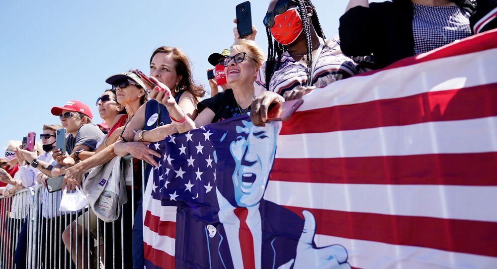 Supporters of Donald Trump wait for him as he arrives in Cleveland in the swing state of Ohio on 6 August 2020.