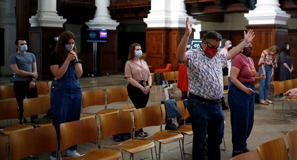 Worshippers attend a Sunday morning service at the Christ Church Spitalfields, amid the spread of the coronavirus disease (COVID-19), in London, Britain August 16, 2020. REUTERS/Henry Nicholls