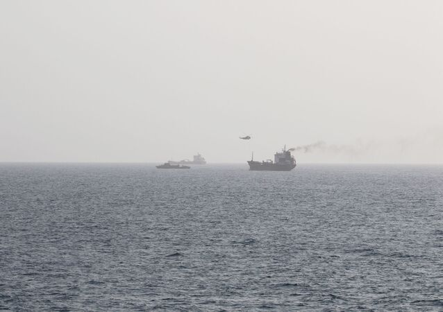 This picture released by the U.S. Navy allegedly shows members of the Iranian forces fast-roping onto civilian tanker WILA en-route to the UAE from a Sea King helicopter, in international waters in the Strait of Hormuz, August 12, 2020