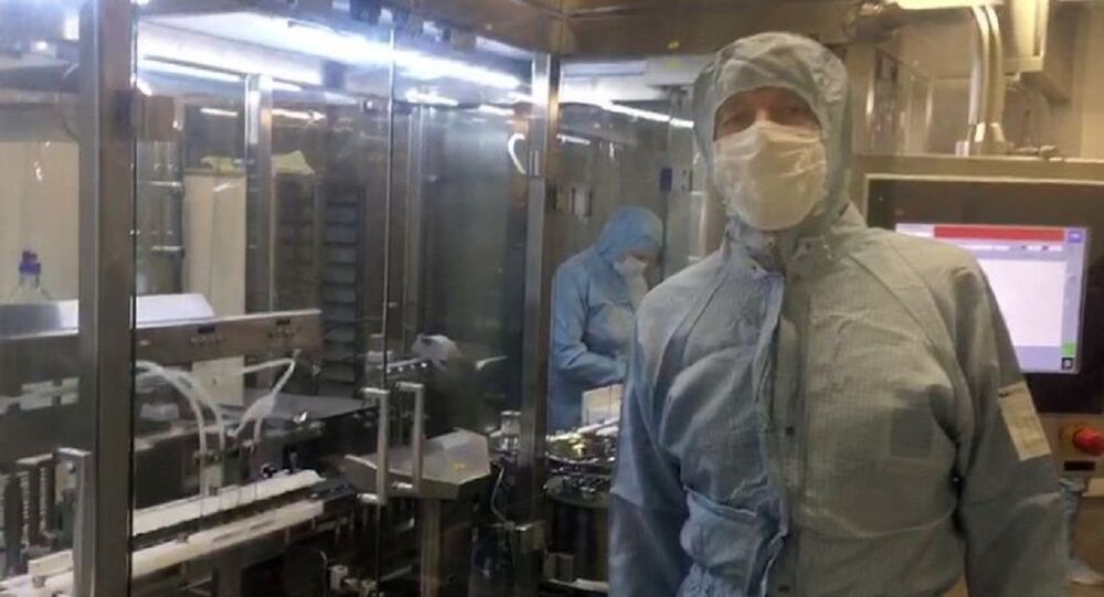 In this handout video grab released by Russian Healthcare Ministry, an employee works at a production line of the world's first vaccine against COVID-19 registered in Russia, in Moscow, Russia. On August 11, Russia announced registering the world's first coronavirus vaccine, dubbed Sputnik V, set to be produced industrially