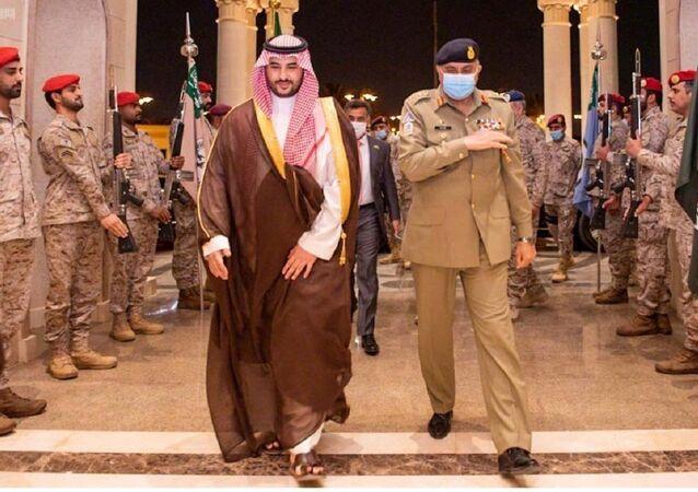 Pakistan's Army Chief of Staff General Qamar Javed Bajwa is welcomed by Saudi Arabia's Deputy Defense Minister Prince Khalid bin Salman, in Riyadh, Saudi Arabia August 17, 2020