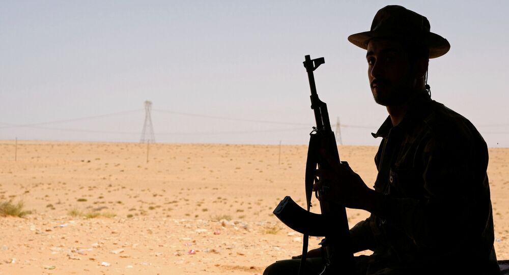 A member of the Libyan National Army (LNA) commanded by Khalifa Haftar sits in a tent at one of their sites in west of Sirte, Libya August 19, 2020