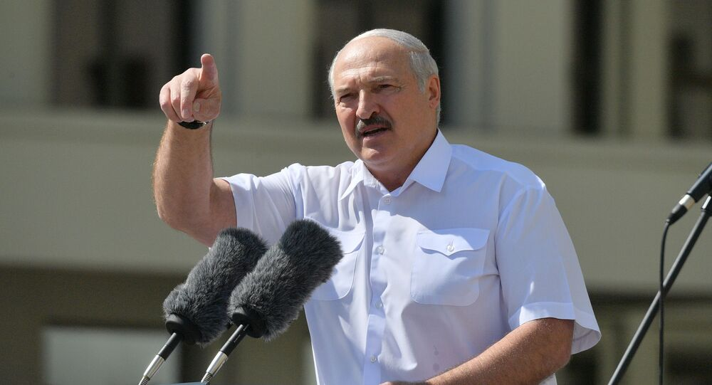 Belarusian President Alexander Lukashenko gestures as he delivers a speech during a rally of his supporters near the Government House in Independence Square in Minsk, Belarus August 16, 2020